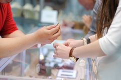 Woman trying wedding rings at a jeweler Stock Photography