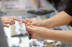 Woman trying wedding rings at a jeweler Stock Image