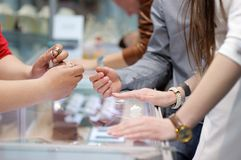 Woman trying wedding rings at a jeweler Royalty Free Stock Photography