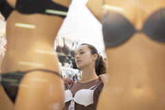Woman Trying On White Bra In Lingerie Store Stock Photo