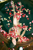 Woman in Tub Surrounded by Flowers - Vertical Royalty Free Stock Image
