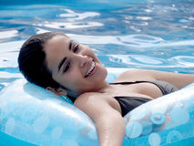 Woman with tube in pool Stock Photo