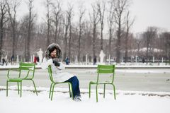 Woman in the Tuileries garden on a winter day Stock Photo