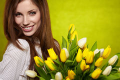 Woman with tulip Stock Images