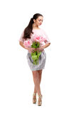 Woman with  tulip bouquet. Beautiful dark-haired woman with  tulip bouquet. Spring Royalty Free Stock Image
