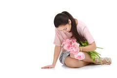 Woman with  tulip bouquet. Beautiful dark-haired woman with  tulip bouquet. Spring Royalty Free Stock Photography