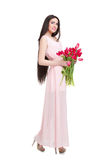 Woman with  tulip bouquet. Beautiful dark-haired woman with  tulip bouquet. Spring Royalty Free Stock Photos