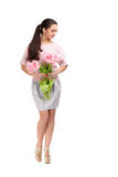 Woman with  tulip bouquet. Beautiful dark-haired woman with  tulip bouquet. Spring Royalty Free Stock Photo