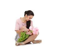 Woman with  tulip bouquet. Beautiful dark-haired woman with  tulip bouquet. Spring Stock Photos