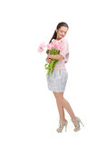 Woman with  tulip bouquet. Beautiful smiling  dark-haired woman with  tulip bouquet. Spring portrait Stock Photography