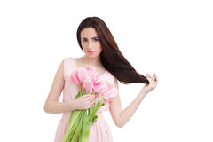 Woman with  tulip bouquet. Portrait of beautiful dark-haired woman with  tulip bouquet. Spring portrait Royalty Free Stock Photos