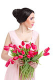 Woman with  tulip bouquet. Portrait of beautiful dark-haired woman with  tulip bouquet. Spring portrait Stock Photos