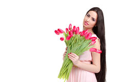 Woman with  tulip bouquet. Portrait of beautiful dark-haired woman with  tulip bouquet. Spring portrait Royalty Free Stock Images