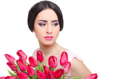Woman with  tulip bouquet. Portrait of beautiful dark-haired woman with  tulip bouquet. Spring portrait Stock Photography