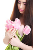 Woman with  tulip bouquet. Portrait of beautiful dark-haired woman with  tulip bouquet. Spring portrait Stock Photo