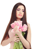 Woman with  tulip bouquet. Portrait of beautiful dark-haired woman with  tulip bouquet. Spring portrait Royalty Free Stock Image