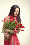 Woman with  tulip bouquet. Portrait of beautiful dark-haired woman with  tulip bouquet. Spring portrait Royalty Free Stock Photography