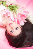 Woman with  tulip bouquet. Portrait of beautiful dark-haired woman with  tulip bouquet. Spring portrait. beauty Stock Photos