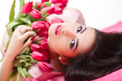Woman with  tulip bouquet. Portrait of beautiful dark-haired woman with  tulip bouquet. Spring portrait. beauty Stock Image