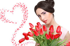 Woman with  tulip bouquet. Portrait of beautiful dark-haired woman with  tulip bouquet. Valentine`s day Stock Photo