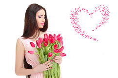 Woman with  tulip bouquet. Portrait of beautiful dark-haired woman with  tulip bouquet. Valentine`s day Royalty Free Stock Images