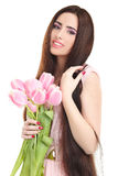 Woman with  tulip bouquet. Portrait of beautiful smiling  dark-haired woman with  tulip bouquet. Spring portrait Royalty Free Stock Photos