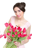 Woman with  tulip bouquet. Portrait of beautiful smiling  dark-haired woman with  tulip bouquet. Spring portrait Stock Photography