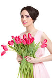 Woman with  tulip bouquet. Portrait of beautiful smiling  dark-haired woman with  tulip bouquet. Spring portrait Royalty Free Stock Photo
