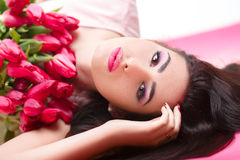 Woman with  tulip bouquet Stock Photo