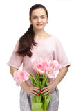 Woman with  tulip bouquet. Portrait of beautiful smiling  dark-haired woman with  tulip bouquet. Spring portrait Royalty Free Stock Image