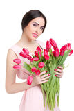 Woman with  tulip bouquet. Portrait of beautiful smiling  dark-haired woman with  tulip bouquet. Spring portrait Royalty Free Stock Photography