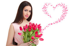 Woman with  tulip bouquet. Portrait of beautiful smiling  dark-haired woman with  tulip bouquet. Valentine`s day Royalty Free Stock Photo