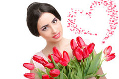 Woman with  tulip bouquet. Portrait of beautiful smiling  dark-haired woman with  tulip bouquet.Valentine`s day Stock Images