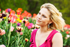 Woman in tulip garden Royalty Free Stock Image