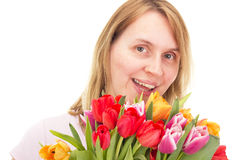 Woman with tulips Stock Images