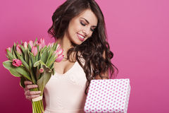 Woman with tulips and box gift Stock Images