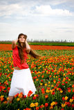 Woman in tulips field Royalty Free Stock Images