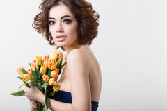 Woman with tulips. Royalty Free Stock Photography