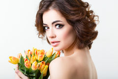 Woman with tulips. Royalty Free Stock Photo