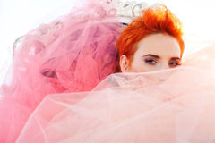 Woman in tulle. Redhead woman covered in tulle Royalty Free Stock Images