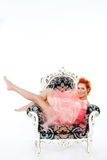 Woman in tulle. Redhead woman covered in tulle sitting on a chair Royalty Free Stock Photos