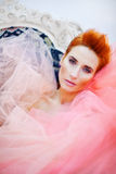 Woman in tulle. Redhead woman covered in tulle Royalty Free Stock Photos