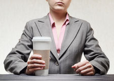 woman with a tumbler of coffee Stock Photos