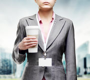woman with a tumbler of coffee Royalty Free Stock Image