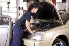 Woman Tuning Car Stock Photography