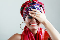 Woman in turban on her head Royalty Free Stock Image