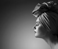 Woman in  turban. Profile of young woman in turban . Copy space for jour text Stock Photos