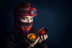 Woman in turban with spices Stock Images