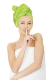 Woman with turban towel make hush gesture. Royalty Free Stock Images