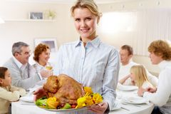 Woman with turkey Royalty Free Stock Photography
